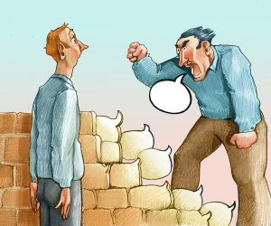 cartoon of man's profanity speech bubbles building a wall between people