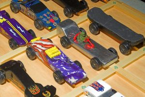 A collection of Pinewood Derby cars ready to race.