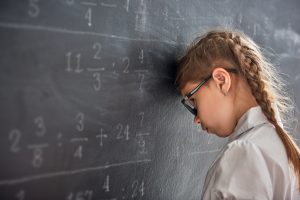 girl bangs her head against the blackboard. Just doesnt get it.