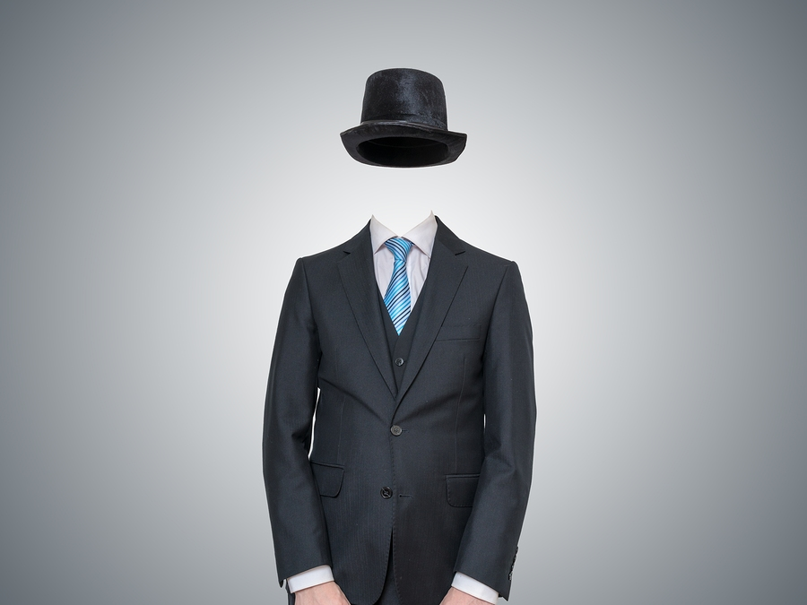 invisible man in suit on gray background. Invisible Influence.